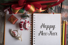 Note book with word happy new year and holiday decoration on woo Stock Photography