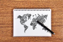 Note book with world map Stock Photos