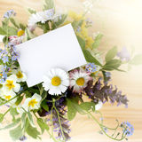 A note by in a bouquet of flowers Royalty Free Stock Photo