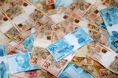 Note brasiliane dei soldi sparse Immagine Stock Libera da Diritti