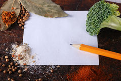 Note, broccoli and spices on a wood cutting board Stock Image