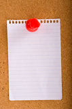 Note on Bulletin board. A blank note on a bulletin board with a push pin. copy space Stock Images
