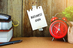 Note with BUSINESS IDEA inscription on wooden background. Royalty Free Stock Photos