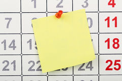 Note on calendar. Closeup of blank note pinned on calendar Royalty Free Stock Images