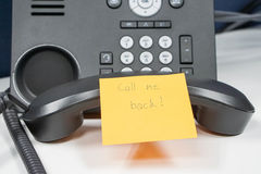 Note of calling back message on IP phone Royalty Free Stock Photography