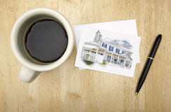 Note Card with House Drawing, Pen and Coffee Royalty Free Stock Image