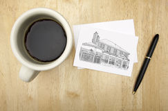 Note Card with House Drawing, Pen and Coffee Royalty Free Stock Photo