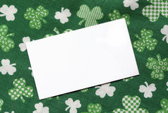 Note Card on St. Patricks Day Background. White note card on background for St. Patrick's Day Stock Photo