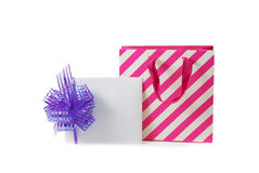Note card with violet bow and white-pink gift bag isolated Royalty Free Stock Image