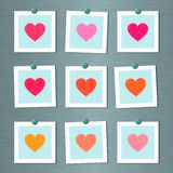 Note cards with painted hearts on wall Stock Photos