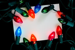 Note-carte de lumière de Noël Photo libre de droits
