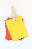 Note Clip. Pieces of paper held together by a clothes peg Royalty Free Stock Photography