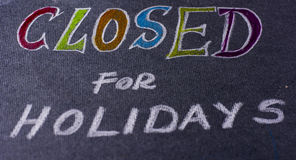 Note for closed on holidays. Closed for holidays note isolated on black background Stock Photography