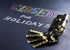 Note for closed on holidays with keys Royalty Free Stock Photography