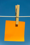 Note on a clothesline Stock Photos