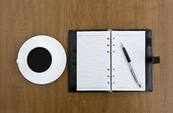 Note and coffee Stock Photos