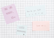 Note. Collection handwrite paper notes on grid background. Side light Royalty Free Stock Images