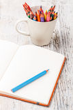 Note and color pencils Royalty Free Stock Image