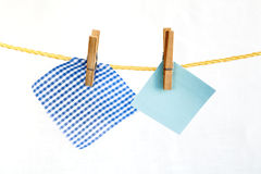 Note colored paper and and piece of checkered fabric Stock Photography