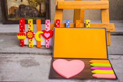 Note and colorful peg. Royalty Free Stock Image