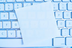 Note on computer keyboard: empty. A memo is on the keyboard of a computer reminder: empty royalty free stock photo