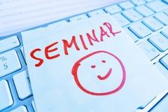 Note on computer keyboard: seminar Stock Photos