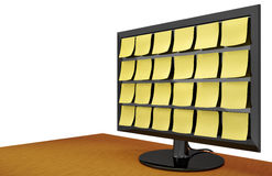 Note Covered Monitor on Desk Stock Images