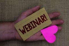 Note d'écriture montrant à Webinar l'appel de motivation Oeuvre d'art du bois de présentation d'elearning de Web d'enseignement à Images stock