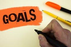Note d'écriture montrant des buts La photo d'affaires présentant des accomplissements désirés vise ce que vous voulez pour accomp Photographie stock libre de droits