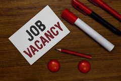 Note d'écriture montrant Job Vacancy Photo d'affaires présentant l'endroit payé vide ou disponible dans la petite ou grande marqu photographie stock libre de droits