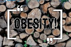 Note d'écriture montrant l'obésité L'excès de présentation de condition médicale de photo d'affaires de la graisse du corps a acc photo libre de droits