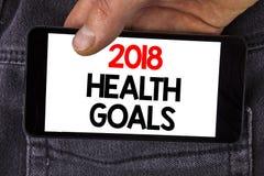 Note d'écriture montrant la santé 2018 Golas Photo d'affaires présentant des buts sains de résolution de nourriture de séance d'e Photos stock