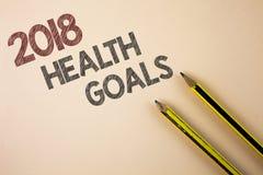 Note d'écriture montrant la santé 2018 Golas Photo d'affaires présentant des buts sains de résolution de nourriture de séance d'e Photographie stock libre de droits