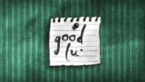 Note de bonne chance sur un mur