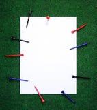 Note de golf avec des chevilles Photo stock