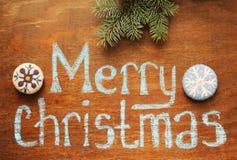 Note de Joyeux Noël et branche, ornements images stock