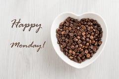 Note de lundi et grain de café heureux Image stock