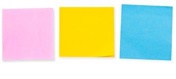 Note de papier de 3 couleurs sur le blanc photos libres de droits