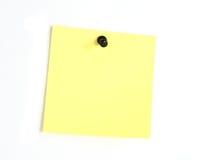 Note de post-it jaune photographie stock libre de droits