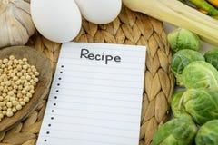 Note de recette, faisant cuire l'ingrédient et le légume image libre de droits