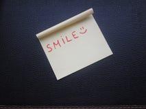 Note de SOURIRE Photographie stock libre de droits