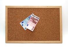 Note dell'euro della scheda del sughero Fotografia Stock