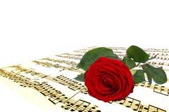 Note della rosa e di musica di colore rosso Fotografie Stock Libere da Diritti