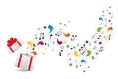 Note di musica dal contenitore di regalo Immagini Stock
