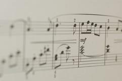 Note di musica su fondo bianco Fotografia Stock