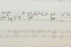 Note di musica su fondo bianco Fotografie Stock