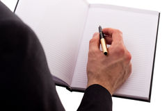 Note di scrittura dell'uomo d'affari su una riunione Immagine Stock Libera da Diritti