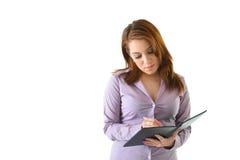 Note di scrittura della donna di affari Immagine Stock