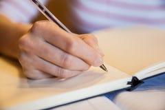 Note di scrittura della studentessa Immagine Stock Libera da Diritti