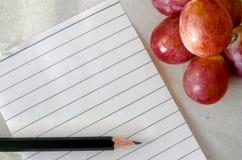 Note e frutta di concetto insieme Fotografia Stock